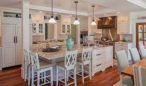 Cottage Kitchen Island The Kitchen Features Whitewash Cabinets And A Large Kitchen Island