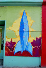 photos 17 fantastical murals rise up from greenwood explosion a rocket painted outside the greater seattle bureau of fearless ideas on greenwood avenue north
