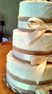 rustic style wedding cake with burlap and ivory ribbon this cake