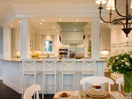 classy white kitchen idea with round kitchen table with marble top