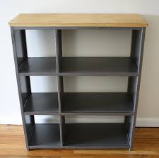 grey stained industrial metal bookcase with maple wooden top plus