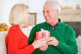 elderly gifts an elderly in exchanging gifts on christmas day