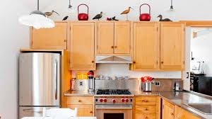 kitchen cabinet top how to decorate the top of kitchen cabinets home design lover