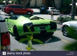 Lamborghini Gallardo Lime Green - rear end of a lime green lamborghini gallardo parked outside the