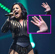 demi lovato u0027s new smiley face pinky tattoo is too cute for words