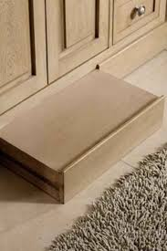 step stool for bathroom sink install a slide away step in your bathroom baseboard to solve your