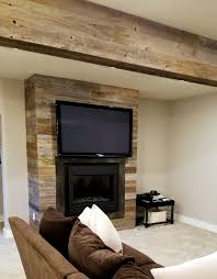 nice look with our reclaimed fencing on a fireplace surround and