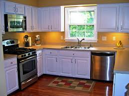 remodeling kitchen cupboard design with metal gas and small
