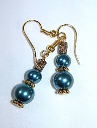 spacer earrings teal blue glass pearl earrings with gold bead and spacer earrings