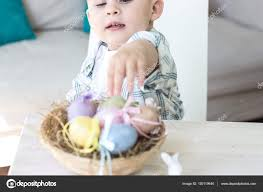 easter plays for children boy plays with easter eggs and the easter bunny
