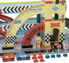 wooden toy garage with racetrack by little ella james