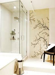 frameless picture hanging frameless clear glass shower barrier plain black countertop orange