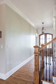 foyer with behr sculptor clay and silky white trim a bm revere