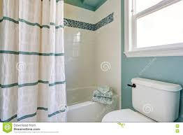 light blue bathroom with tile trim stock photo image 39702912
