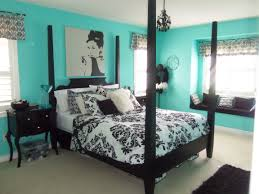 lovely damask bedroom with black canopy bed and teal walls and