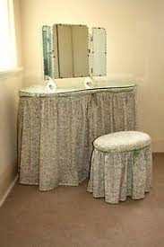 toile covered vanity with swing out arms for storage leland