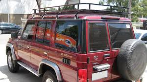 red land cruiser toyota landcruiser 70 series with commercial max roof rack pic 1