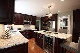dark wood kitchen cabinets absolutely perfect double ovens wine cooler dark cabinets light