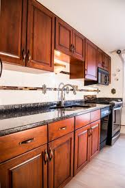 how to clean my cherry wood kitchen cabinets frederick md cherry cabinets national refacing systems
