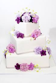 wedding cake roses white fondant wedding cake with square tiers decorated with pink