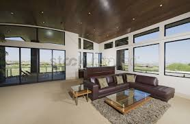 interior with furniture and large windows with outside views stock
