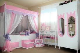 lovely girls room with canopy bed and white closet as teen bedroom