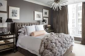 light pink fur blanket brass and glass vintage nightstands contemporary bedroom