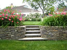 backyards with slopes design slope land stony flowers bed and