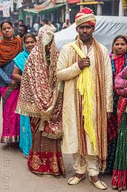 indian wedding groom newlyweds indian wedding groom holding in tow like a trophy