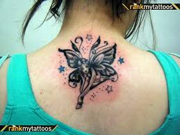 colored fairy tattoo on upperback