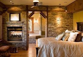 rustic master bedroom with wood bedframe by kogan builders
