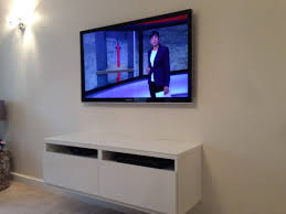 Wall Mounted Tv Ideas by White Floating Shelves And Stylish Wall Mounted Tv For Perfect