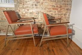 pair of steelcase mid century industrial arm chairs galaxiemodern