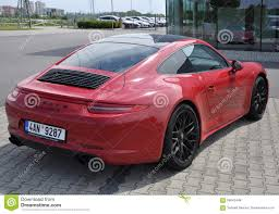 red porsche 911 back of red porsche 911 carrera 4 gts editorial stock photo