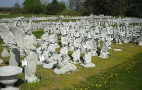 different view of some of the concrete garden statues at warmbier