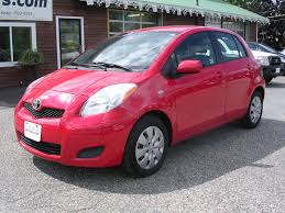 my 22nd and current vehicle a red 2009 toyota yaris 4 door