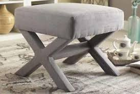 gray linen fabric upholstered ottoman with x shape legs by coaster