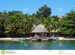 overwater bungalow with lush tropical vegetation stock photo