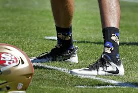 colin kaepernick criticized for wearing police pig socks time