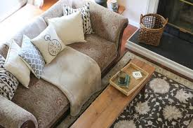 Throws For Sofa by Updating A Dated Sofa Home Staging Trick From The Decorologist