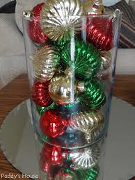 ornaments in vase reflecting in mirror puddy s house
