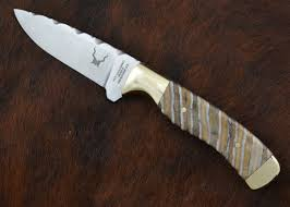 a fine handmade custom hunting knife made by m g muhlhauser m g muhlhauser and sohne custom knife with mammoth tooth handle handmade in the usa