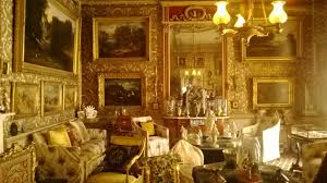 the un stately home ruth downie room crammed with gold framed paintings and elegant furniture