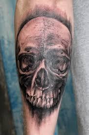 realistic looking black skull tattoo tattoomagz