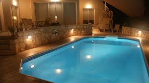 the pool at night villa yiamas