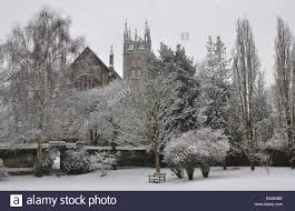 st mary s church from the rectory garden with snow warwick stock