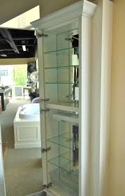 large white stained wooden frame medicine cabinet with wire rack