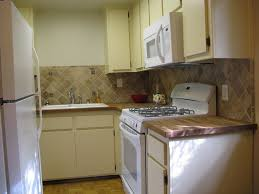 quiet comfort in popular railroad district vrbo the oak kitchen with travertine backsplash and butcher block counters