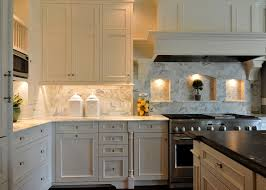 traditional kitchen with stone tile by custom kitchens by martin