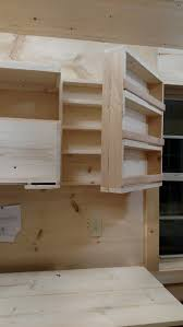 best ideas about tiny house storage pinterest roof joist this clever storage shelving that hinge opens more hidden behind